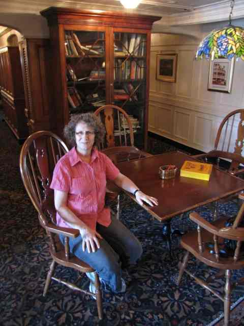 Linda Aksomitis in the library on board the Delta Queen River Boat Hotel.