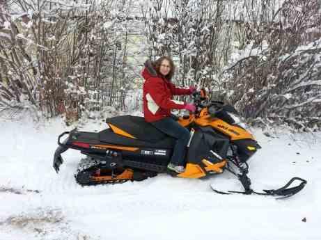 Linda Aksomitis on her new 2014 Ski-Doo waiting for a little more snow!