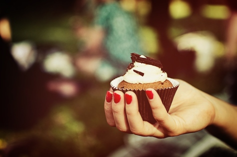 Photo of a woman holding a cupcake from Vintage Style Photos Collection VI.